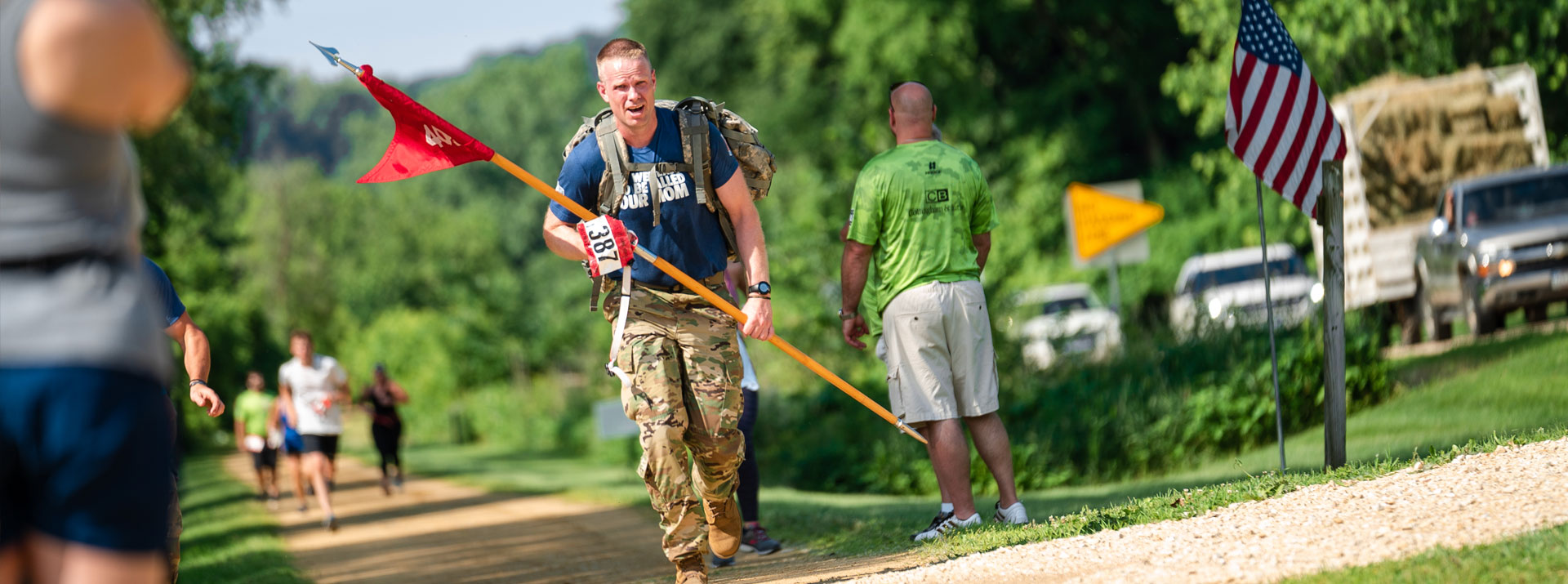 Runner wearing Military Fatigues at Run4Troops in Dubuque, Iowa